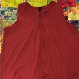Loose fitting sleeveless blouse